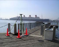 Wide shot of a tripod survey tool overlooking a pier